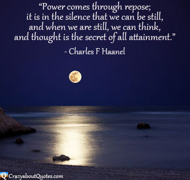 Moonlight shining on shore and rocks with Charles Haanel quote.