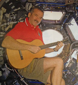 Chris Hadfield on guitar in spacecraft.