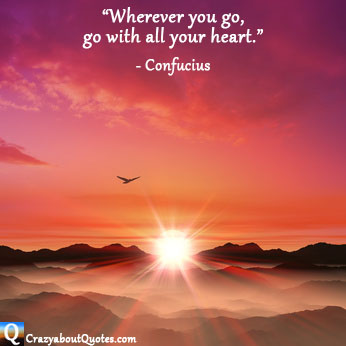 Warm glowing sunset over misty mountains with Confucius quote.