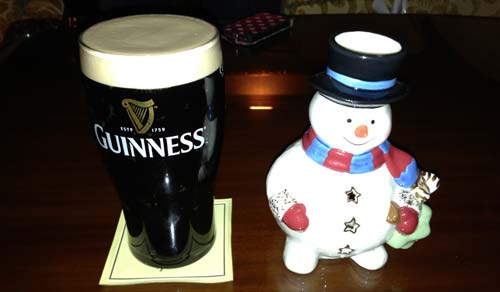 Pint of Guinness and happy snowman.