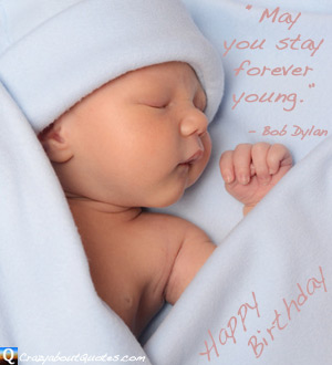 New born baby wrapped in blanket with happy birthday quote.