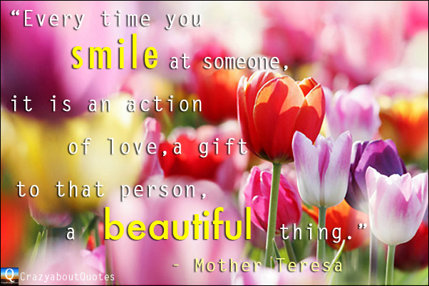 Beautiful red and purple tulips with quote about love from Mother Teresa.