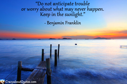 Beautiful sunset over sea with jetty and Benjamin Franklin quote about worry.