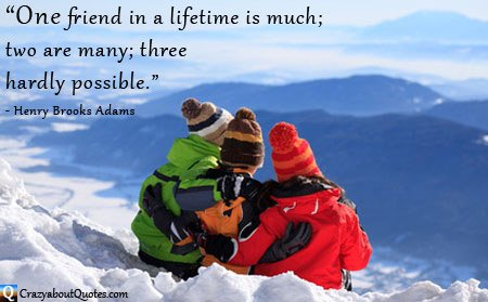 Three friends on snow covered mountain top with friendship quote.