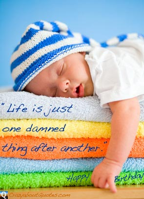 New born baby asleep on soft towels with funny birthday quote.