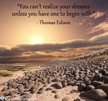 Sunrise on stoney beach with Thomas Edison quote about dreams.
