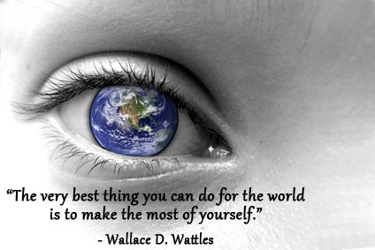 The world in the pupil of an eye with Wallace Wattles quote.
